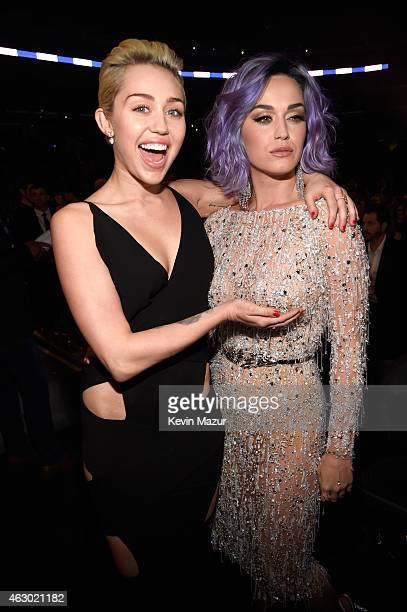 Miley Cyrus and Katy Perry attend The 57th Annual GRAMMY Awards at STAPLES Center on February 8 2015 in Los Angeles California