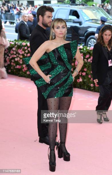 Miley Cyrus and Liam Hemsworth arrive for the 2019 Met Gala celebrating Camp Notes on Fashion at The Metropolitan Museum of Art on May 06 2019 in New...