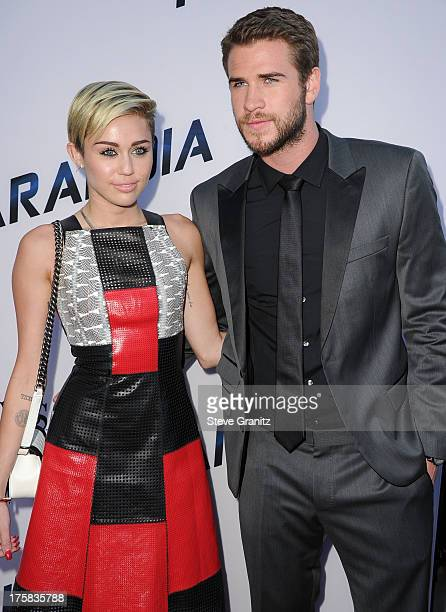 Miley Cyrus and Liam Hemsworth arrives at the Paranoia Los Angeles Premiere at DGA Theater on August 8 2013 in Los Angeles California
