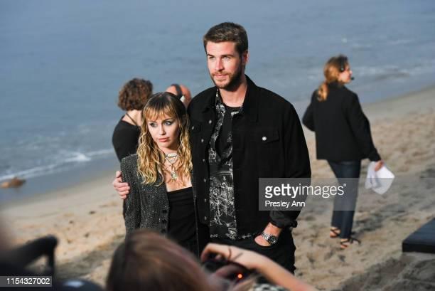 Miley Cyrus and Liam Hemsworth at Saint Laurent mens spring summer 20 show on June 06 2019 in Malibu California