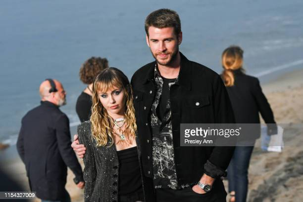 Miley Cyrus and Liam Hemsworth at Saint Laurent mens spring summer 20 show on June 06 2019 in Malibu California