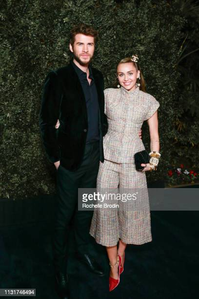 Miley Cyrus and Liam Hemsworth attend Chanel And Charles Finch Pre-Oscar Awards Dinner at Polo Lounge at The Beverly Hills Hotel on February 23, 2019...