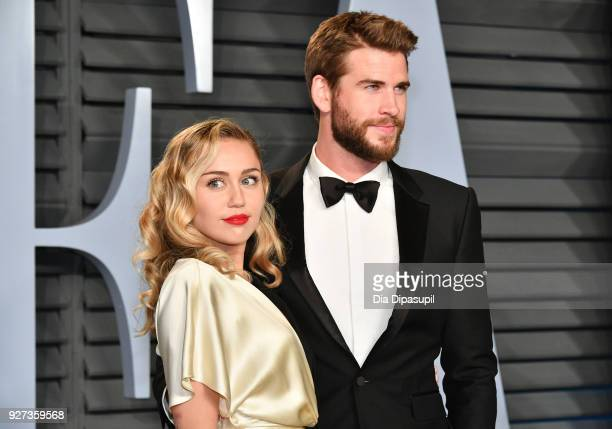 Miley Cyrus and Liam Hemsworth attend the 2018 Vanity Fair Oscar Party hosted by Radhika Jones at Wallis Annenberg Center for the Performing Arts on...