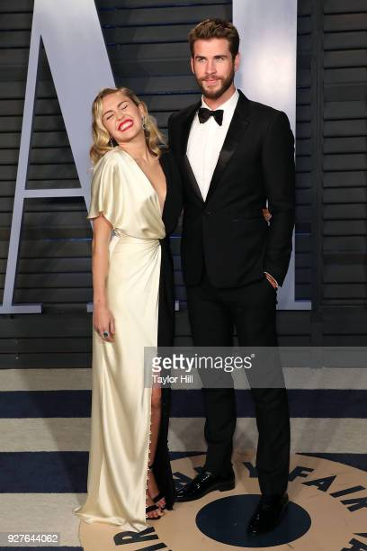 Miley Cyrus and Liam Hemsworth attend the 2018 Vanity Fair Oscar Party hosted by Radhika Jones at the Wallis Annenberg Center for the Performing Arts...