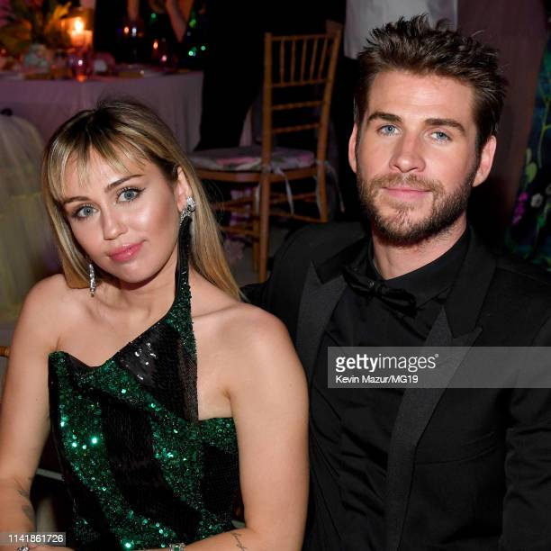 Miley Cyrus and Liam Hemsworth attend The 2019 Met Gala Celebrating Camp Notes on Fashion at Metropolitan Museum of Art on May 06 2019 in New York...