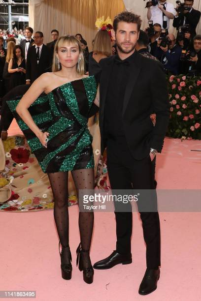 Miley Cyrus and Liam Hemsworth attend the 2019 Met Gala celebrating Camp Notes on Fashion at The Metropolitan Museum of Art on May 6 2019 in New York...