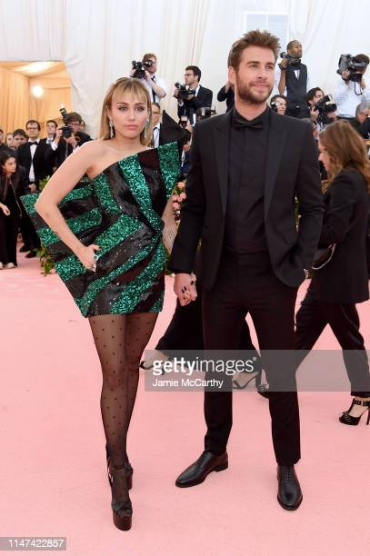 Miley Cyrus and Liam Hemsworth attend The 2019 Met Gala Celebrating Camp: Notes on Fashion at Metropolitan Museum of Art on May 06, 2019 in New York...
