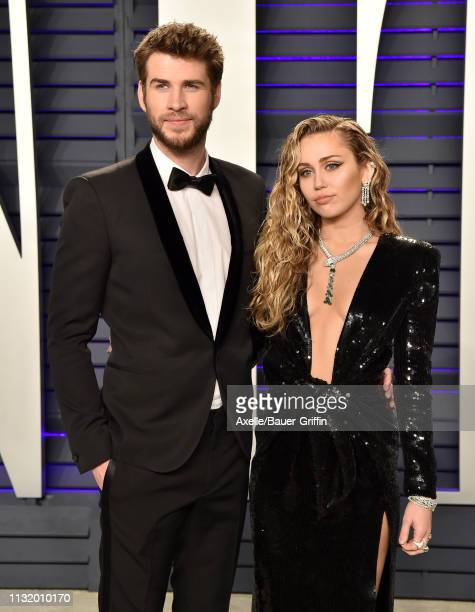 Miley Cyrus and Liam Hemsworth attend the 2019 Vanity Fair Oscar Party Hosted By Radhika Jones at Wallis Annenberg Center for the Performing Arts on...