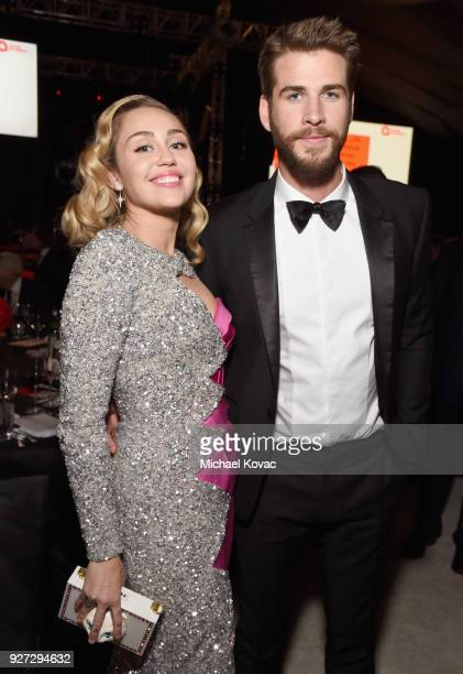 Miley Cyrus and Liam Hemsworth attend the 26th annual Elton John AIDS Foundation Academy Awards Viewing Party sponsored by Bulgari celebrating EJAF...