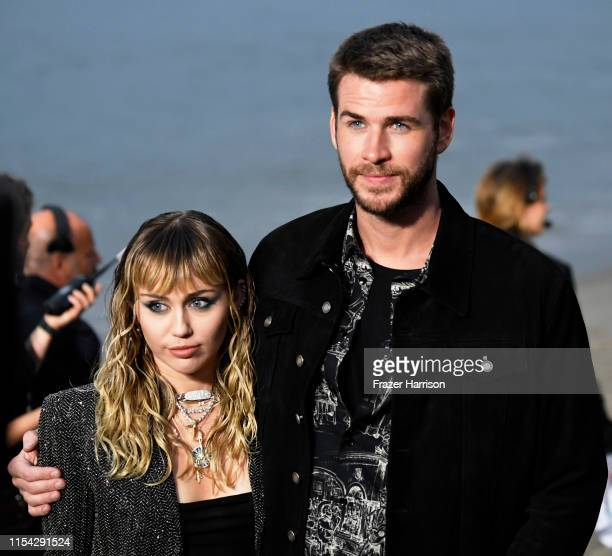 Miley Cyrus and Liam Hemsworth attend the Saint Laurent Mens Spring Summer 20 Show on June 06 2019 in Paradise Cove Malibu California