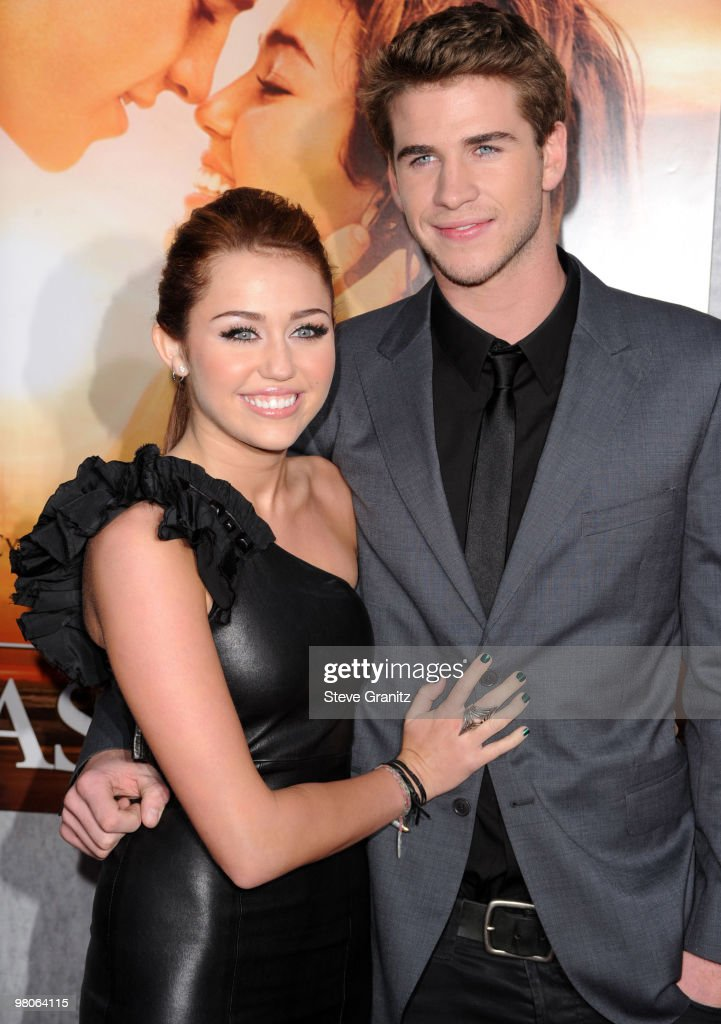 Miley Cyrus and Liam Hemsworth attends the 'The Last Song' Los Angeles Premiere at ArcLight Hollywood on March 25, 2010 in Hollywood, California.