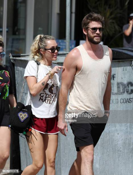 COAST QLD Miley Cyrus and Liam Hemsworth leaving the Rick Shores restaurant in Burleigh Heads on the Gold Coast Queensland
