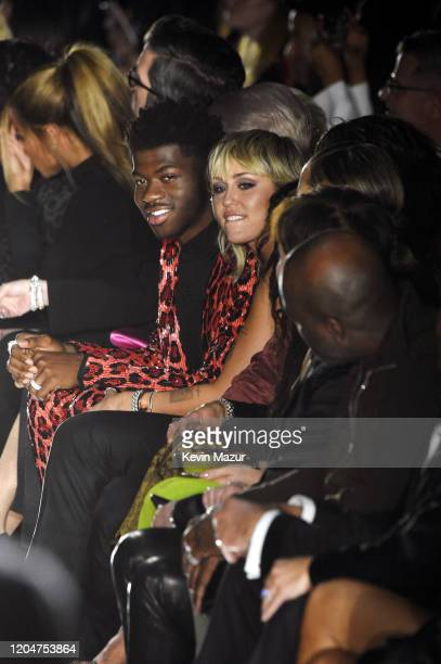 Miley Cyrus and Lil Nas X attend the Tom Ford AW20 Show at Milk Studios on February 07 2020 in Hollywood California