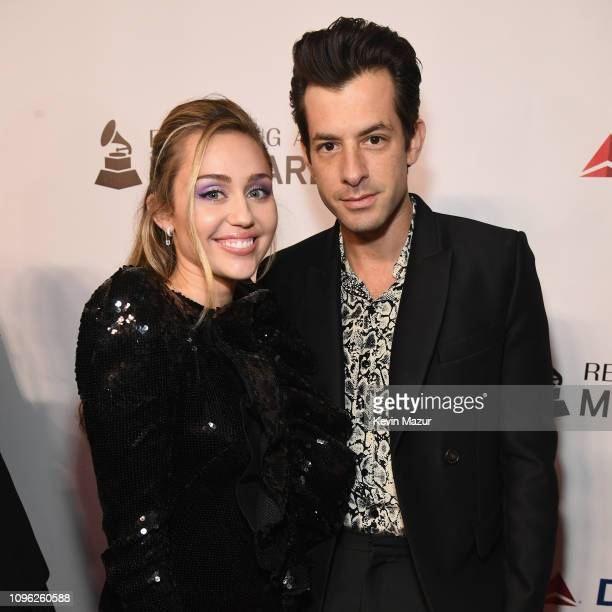 Miley Cyrus and Mark Ronson attend MusiCares Person of the Year honoring Dolly Parton at Los Angeles Convention Center on February 8 2019 in Los...