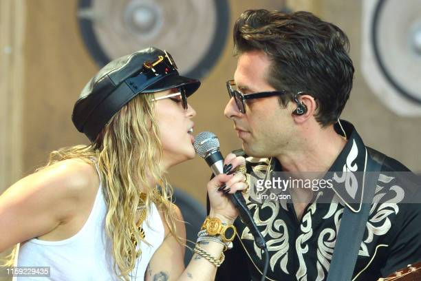 Miley Cyrus and Mark Ronson live on stage during day five of Glastonbury Festival at Worthy Farm Pilton on June 30 2019 in Glastonbury England The...