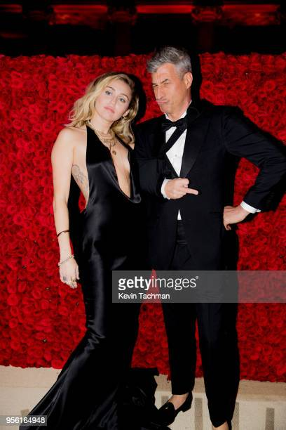 Miley Cyrus and Maurizio Cattelan attend the Heavenly Bodies Fashion The Catholic Imagination Costume Institute Gala at The Metropolitan Museum of...