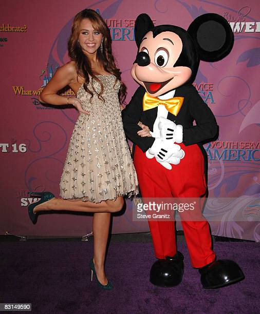 Miley Cyrus and Mickey Mouse arrives at the Miley Cyrus's 'Sweet 16' Celebration At Disneyland on October 5 2008 in Anaheim California