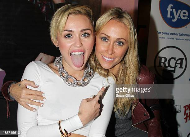 Miley Cyrus and mother Tish Cyrus attend the Miley Cyrus Bangerz Record Release Signing at Planet Hollywood Times Square on October 8 2013 in New...