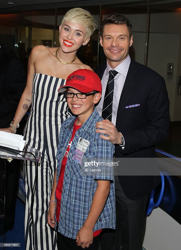Miley Cyrus and Ryan Seacrest visit The Ryan Seacrest Foundation West Coast Debut Of New Multi-Media Broadcast Center 'Seacrest Studios' at CHOC Children's Hospital on March 22, 2013 in Orange, California.