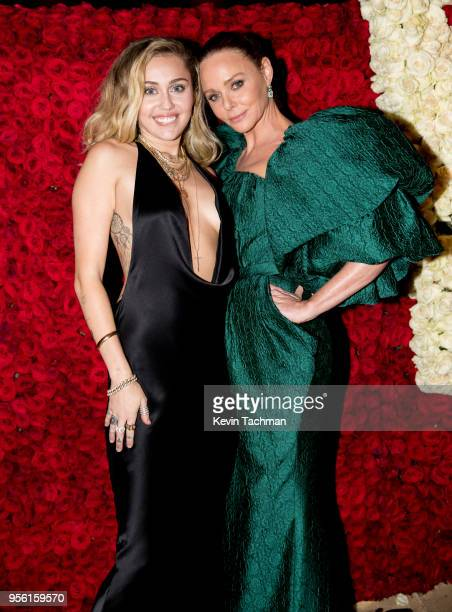 Miley Cyrus and Stella McCartney attend the Heavenly Bodies Fashion The Catholic Imagination Costume Institute Gala at The Metropolitan Museum of Art...