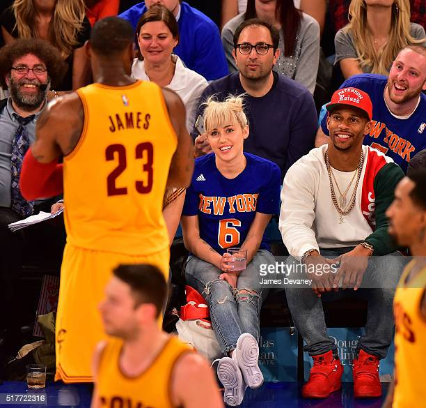Miley Cyrus and Victor Cruz attend the Cleveland Cavaliers vs New York Knicks game at Madison Square Garden on March 26 2016 in New York City