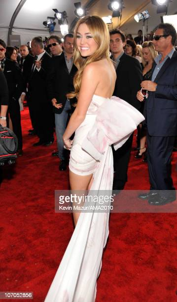 Miley Cyrus arrives at the 2010 American Music Awards held at Nokia Theatre L.A. Live on November 21, 2010 in Los Angeles, California.