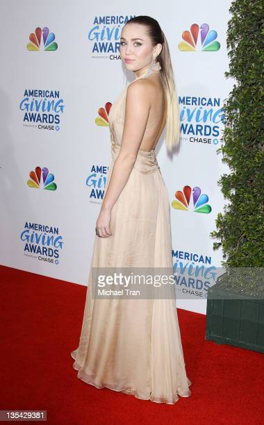 Miley Cyrus arrives at the 2011 American Giving Awards held at Dorothy Chandler Pavilion on December 9 2011 in Los Angeles California