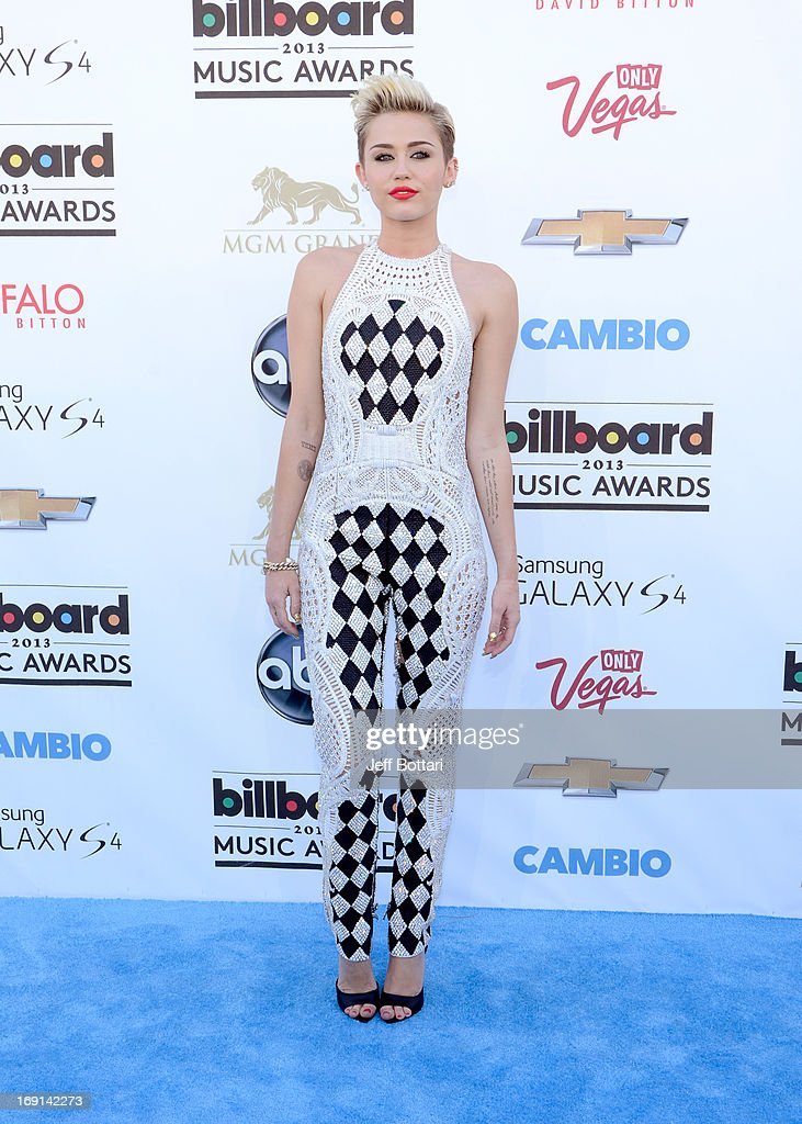 Miley Cyrus arrives at the 2013 Billboard Music Awards at the MGM Grand Garden Arena on May 19, 2013 in Las Vegas, Nevada.