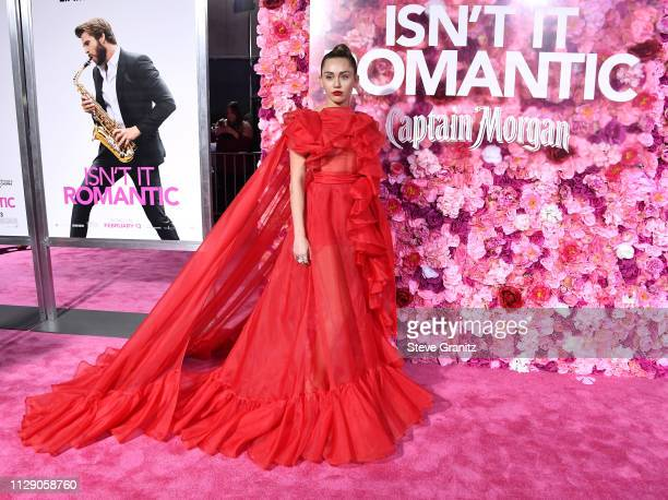 "Miley Cyrus arrives at the Premiere Of Warner Bros. Pictures' ""Isn't It Romantic"" at The Theatre at Ace Hotel on February 11, 2019 in Los Angeles,..."