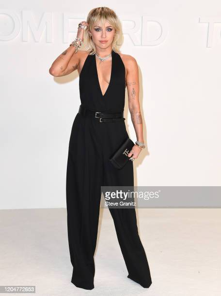 Miley Cyrus arrives at the Tom Ford AW20 Show at Milk Studios on February 07, 2020 in Hollywood, California.