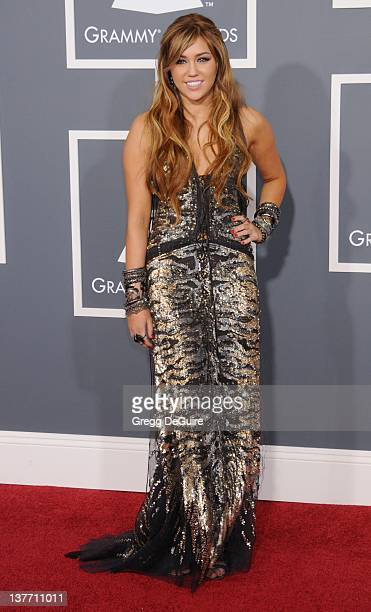 Miley Cyrus arrives for the 53rd Annual GRAMMY Awards at the Staples Center, February 13, 2011 in Los Angeles, California.