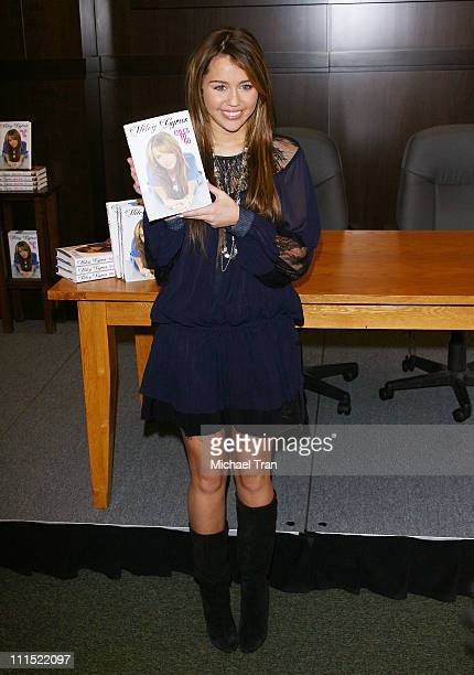 Miley Cyrus attends signs copies of her new book ''Miles to Go'' at the Barnes Noble at The Grove on March 7 2009 in Los Angeles California