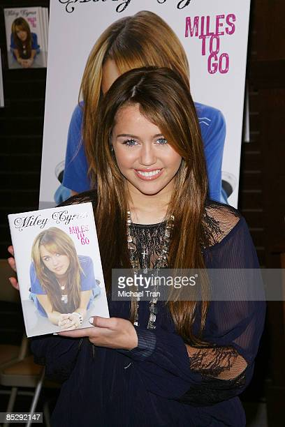 Miley Cyrus attends signs copies of her new book ''Miles to Go'' at the Barnes & Noble at The Grove on March 7, 2009 in Los Angeles, California.