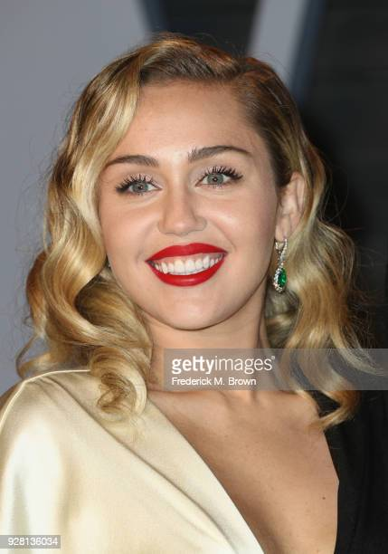 Miley Cyrus attends the 2018 Vanity Fair Oscar Party hosted by Radhika Jones at Wallis Annenberg Center for the Performing Arts on March 4 2018 in...
