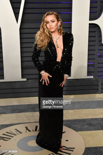 Miley Cyrus attends the 2019 Vanity Fair Oscar Party hosted by Radhika Jones at Wallis Annenberg Center for the Performing Arts on February 24 2019...