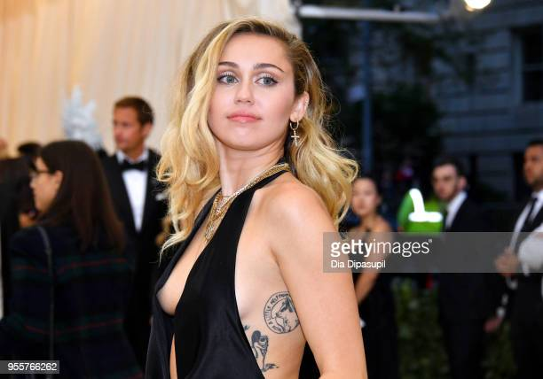 Miley Cyrus attends the Heavenly Bodies Fashion The Catholic Imagination Costume Institute Gala at The Metropolitan Museum of Art on May 7 2018 in...
