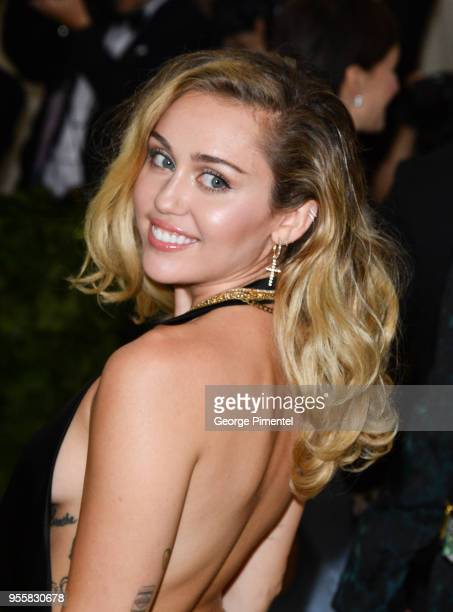Miley Cyrus attends the Heavenly Bodies Fashion The Catholic Imagination Costume Institute Gala at Metropolitan Museum of Art on May 7 2018 in New...