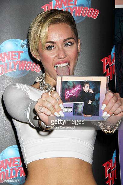 Miley Cyrus attends the Miley Cyrus Bangerz Record Release Signing at Planet Hollywood Times Square on October 8 2013 in New York City
