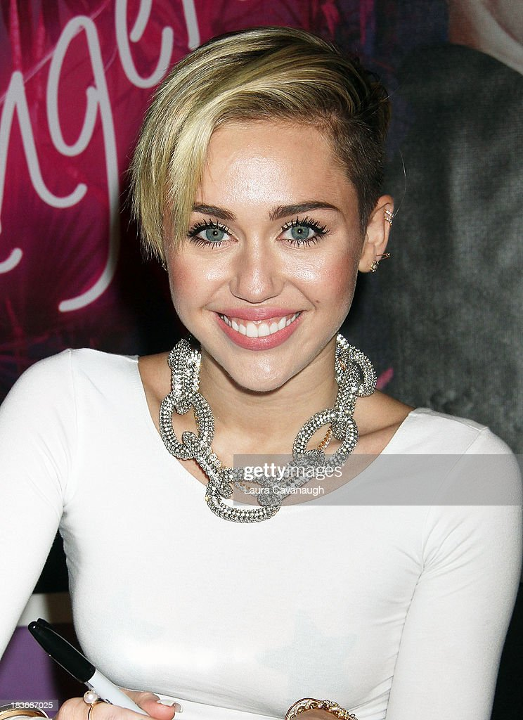 Miley Cyrus attends the Miley Cyrus 'Bangerz' Record Release Signing at Planet Hollywood Times Square on October 8, 2013 in New York City.