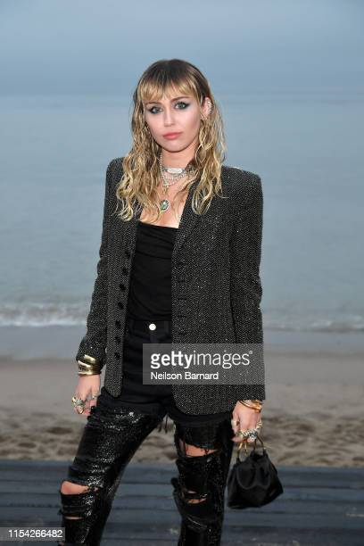 Miley Cyrus attends the Saint Laurent Mens Spring Summer 20 Show on June 06 2019 in Paradise Cove Malibu California