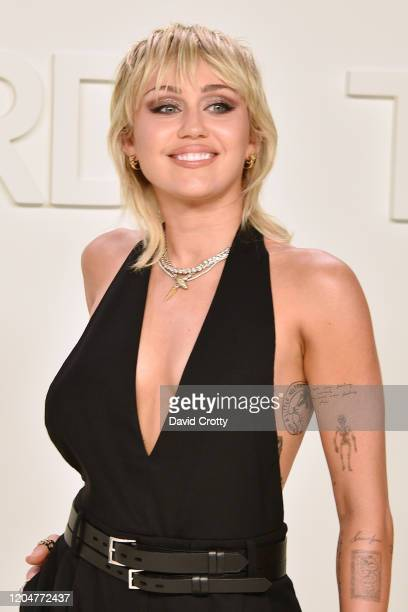 Miley Cyrus attends the Tom Ford AW/20 Fashion Show at Milk Studios on February 07, 2020 in Los Angeles, California.