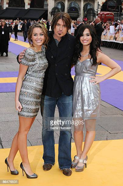 Miley Cyrus Billy Ray Cyrus and Demi Lovato arrive at the UK film premiere of 'Hannah Montana The Movie' held at the Odeon Leicester Square on April...