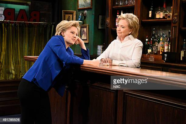 """Miley Cyrus"""" Episode 1684 -- Pictured: Kate McKinnon as Hillary Clinton and Hillary Clinton as Val during the """"Bar Talk"""" sketch on October 3, 2015 --"""