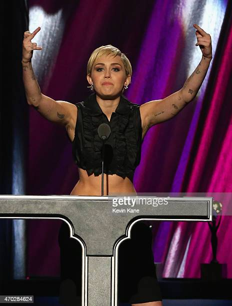 Miley Cyrus inducts Joan Jett and the Blackhearts onstage during the 30th Annual Rock And Roll Hall Of Fame Induction Ceremony at Public Hall on...