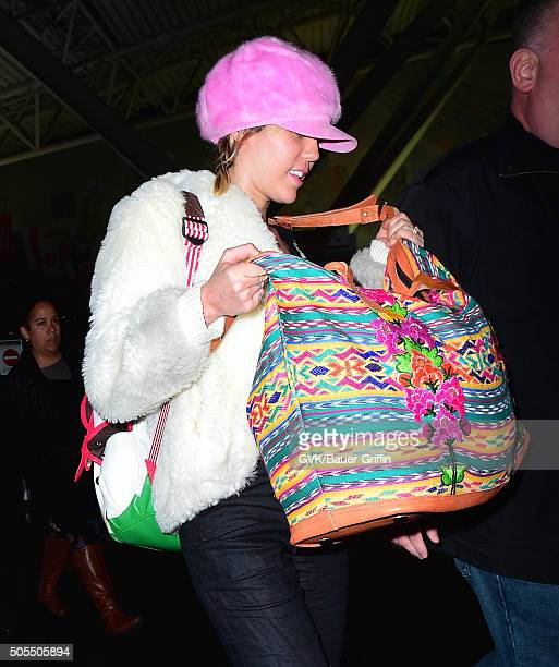Miley Cyrus is seen at JFK on January 18 2016 in New York City