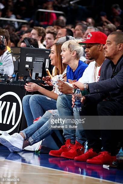 Miley Cyrus is seen during the game between the Cleveland Cavaliers and the New York Knicks at Madison Square Garden in New York City on March 26...