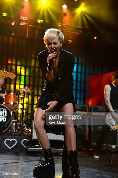 Miley Cyrus Joan Jett and Tommy James perform onstage during the 30th Annual Rock And Roll Hall Of Fame Induction Ceremony at Public Hall on April 18...