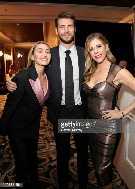 Miley Cyrus Liam Hemsworth and Rita Wilson attend WCRF's 'An Unforgettable Evening' at the Beverly Wilshire Four Seasons Hotel on February 28 2019 in...