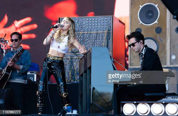 Miley Cyrus Mark Ronson perform on The Pyramid Stage during day five of Glastonbury Festival at Worthy Farm Pilton on June 30 2019 in Glastonbury...
