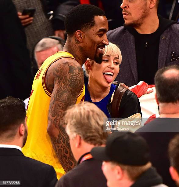 Miley Cyrus meets JR Smith after the Cleveland Cavaliers vs New York Knicks game at Madison Square Garden on March 26 2016 in New York City